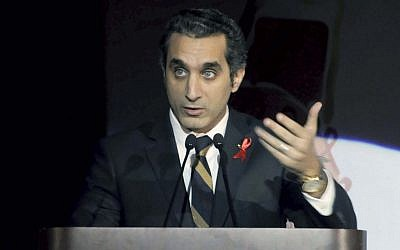Egyptian TV host Bassem Youssef addresses attendants at a gala dinner party in Cairo, Egypt, on December 8, 2012 (photo credit: AP/Ahmed Omar)