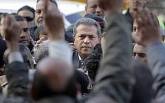 Popular Egyptian TV presenter Tawfiq Okasha is greeted by his supporters as he arrives at the Cairo South court in Cairo Egypt, on Tuesday, January 8, 2013.  (photo credit: AP Photo/Amr Nabil)