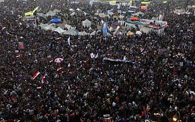 Thousands of Egyptian protesters gather in Tahrir Square, Cairo, Egypt, Friday, January 25 (photo credit: AP/Khalil Hamra)