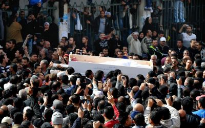 Egyptians carry the coffin of a man killed during a mass funeral in Port Said, Egypt, on Sunday, January 27, 2013. (photo credit: AP Photo)