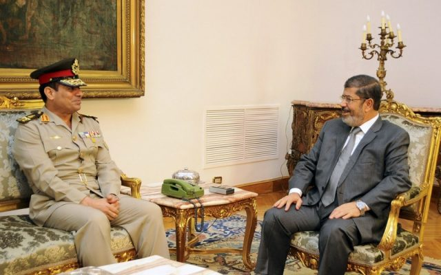 Egyptian Defense Minister Lt. Gen. Abdel-Fattah el-Sissi meets with Egyptian President Mohammed Morsi in Cairo, Egypt, in August 2012. (photo credit: AP/Egyptian Presidency/File)