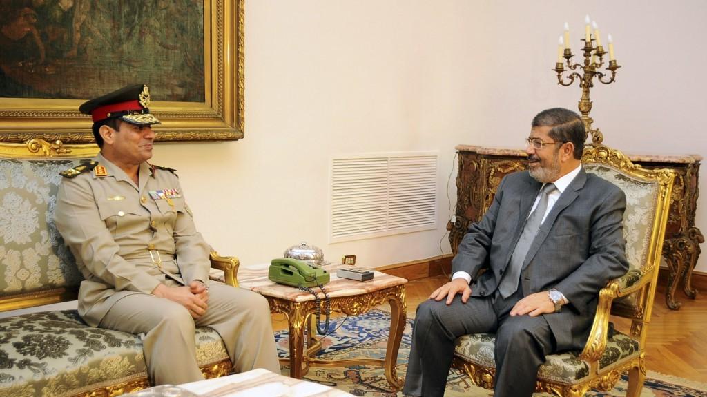 Egyptian Defense Minister Lt. Gen. Abdel-Fattah el-Sissi, left, meets with Egyptian President Mohammed Morsi in Cairo, Egypt, last August (photo credit: AP/Egyptian Presidency/File)