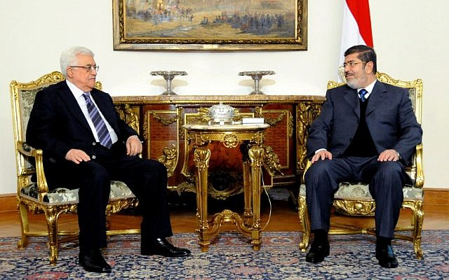 January 2013 meeting between Egyptian President Mohammed Morsi (right) and Palestinian President Mahmoud Abbas in Cairo. (photo credit: AP/Egyptian Presidency)