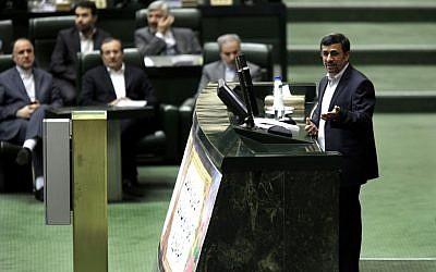 Iranian President Mahmoud Ahmadinejad speaks at the parliament in Tehran, Iran, Wednesday, Jan. 16 (photo credit: AP/Vahid Salemi)