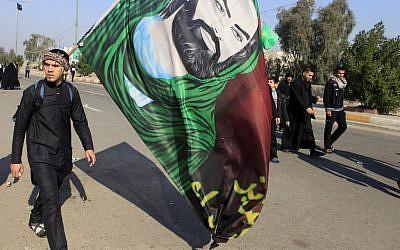 Shiite pilgrims march on their way to Karbala for Arbaeen in Baghdad, Iraq, Monday, Dec. 31, 2012 (photo credit: AP/Karim Kadim)