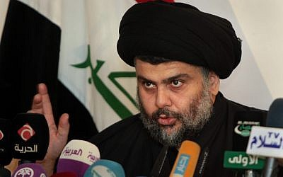 Shiite cleric Muqtada al-Sadr speaks during a press conference in the Shiite holy city of Najaf, 100 miles (160 kilometers) south of Baghdad, Iraq, Tuesday, Jan 1, 2013 (AP/Alaa Al-Marjani)