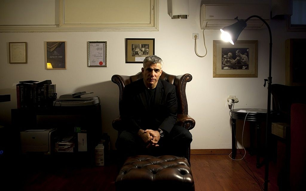 Yair Lapid in his home this week. (photo credit: AP/Oded Balilty)