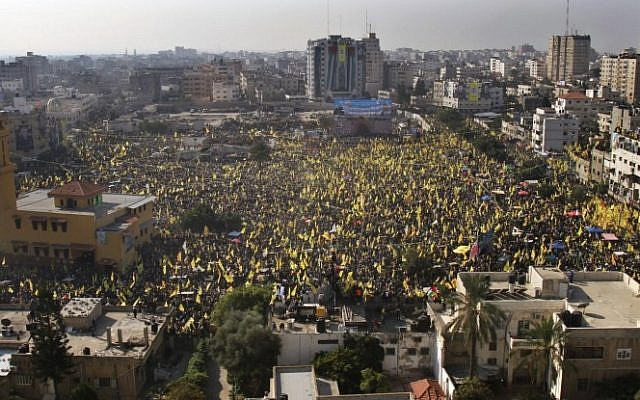 Tens of thousands of Fatah supporters rallying in Gaza City Friday. (photo credit: AP/Adel Hana)
