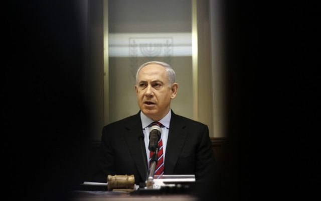 Prime Minister Benjamin Netanyahu heads the weekly Cabinet meeting at his Jerusalem office, Sunday, Jan. 27, 2013. (photo credit: AP/Ariel Schalit)
