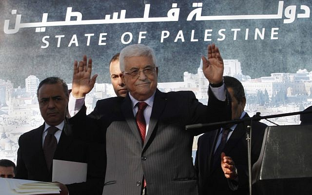 Palestinian President Mahmoud Abbas waves to the crowd during celebrations for their successful bid to win UN statehood recognition on Dec. 2, 2012. (photo credit: Nasser Shiyoukhi/AP)