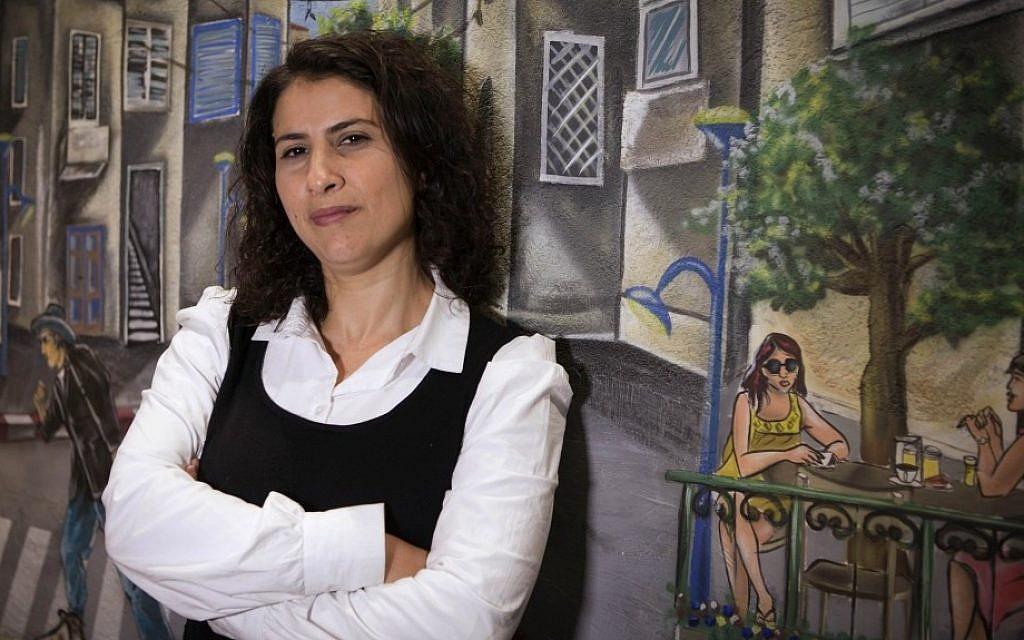 Asma Aghbaria-Zahalka, the head of the Daam party, poses for a photograph in Tel Aviv on Thursday. (photo credit: AP/Dan Balilty)