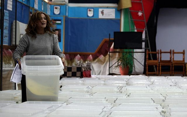 A member of the Jordanian Independent Electoral Commission carries a polling box to be distributed to the polling stations, one day before the designated date of the Jordanian parliamentary elections, in Amman, Jordan, Tuesday, Jan. 22, 2013 (photo credit: AP/Mohammad Hannon)
