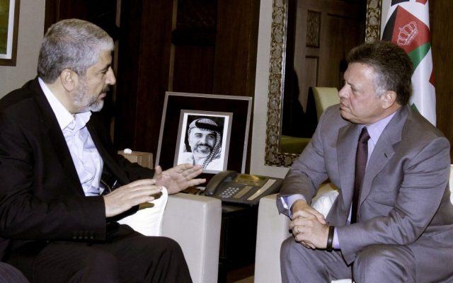 Jordan's King Abdullah II, right, meets with  former Hamas leader Khaled Mashaal, in Amman, Jordan, January 28, 2013 (photo credit: AP/Raad Adayleh)