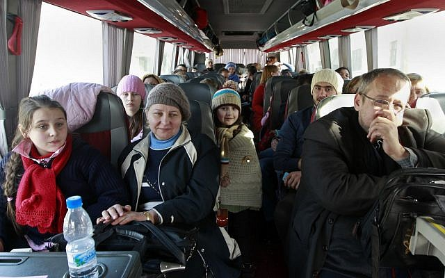 A group of Russian citizens ride a bus shortly after crossing the border from Syria into Lebanon at the Masnaa border crossing Tuesday, Lebanon, Jan. 22, 2013 (photo credit: AP/Bilal Hussein)