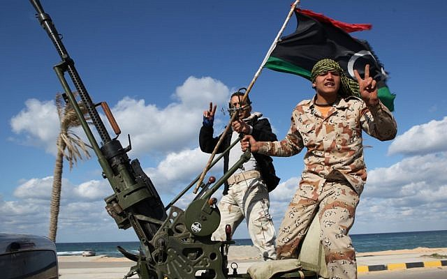 Libyan militias from towns throughout the country's west parade through Tripoli, Libya in February 2012. (photo credit: AP/ Abdel Magid Al Fergany)