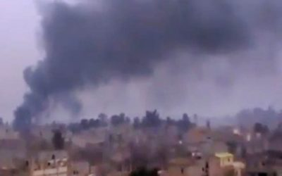 Smoke rises from heavy shelling in Deir el-Zour, Syria, on Monday, January 28, 2013. (photo credit: AP Photo/Ugarit News via AP video)