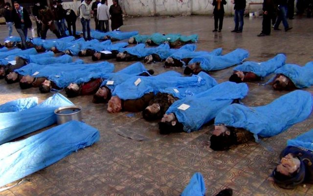 This citizen journalism image shows dead bodies on a street in Aleppo, Syria, Tuesday, January 29, 2013. Syrian activists say at least 65 bodies, some of them with their hands tied behind their back, found on a river bank in the northern city of Aleppo. (photo credit: AP/Aleppo Revolution Against Assad Regime)