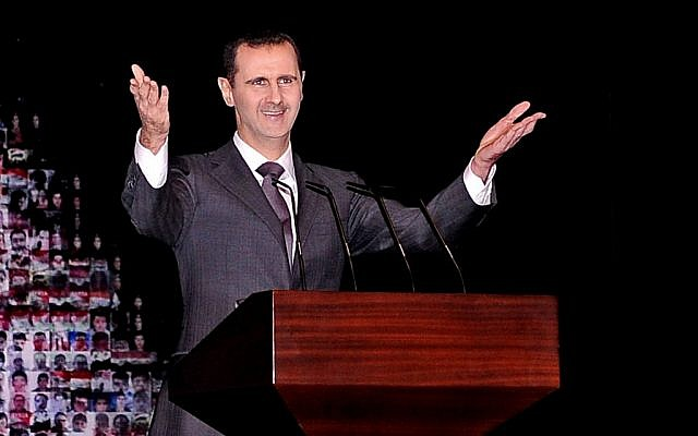 In this photo released by the Syrian official news agency SANA, Syrian President Bashar Assad gestures as he speaks at the Opera House in central Damascus, Syria, Sunday, Jan. 6, 2013 (Photo credit: AP/SANA)