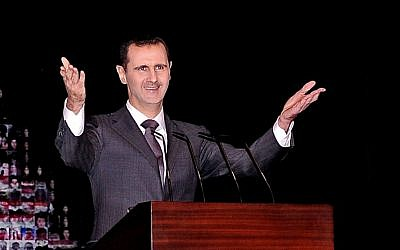 Syrian President Bashar Assad gestures as he speaks at the Opera House in central Damascus, Syria, in January (photo credit: AP/SANA)