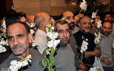 Freed Iranian hostages who were captured by the Syrian rebels since August, after their release in a prisoner swap in Damascus on Wednesday. (photo credit: AP/SANA)