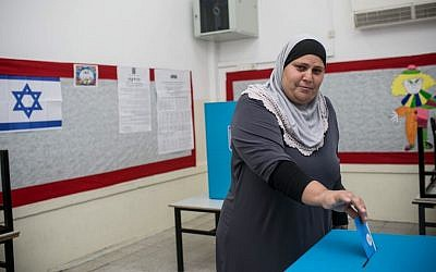 A resident of Jaffa casts her vote Tuesday (photo credit: Noam Moskovich/The Israel Project)