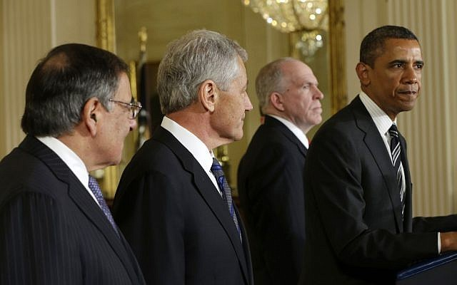 President Barack Obama speaks in the East Room of the White House in Washington on Monday to announce his nomination of John Brennan, second from the right, as the new CIA director, and former Nebraska senator Chuck Hagel, second from the left, as the new Defense Secretary. (photo credit: AP/Pablo Martinez Monsivais)