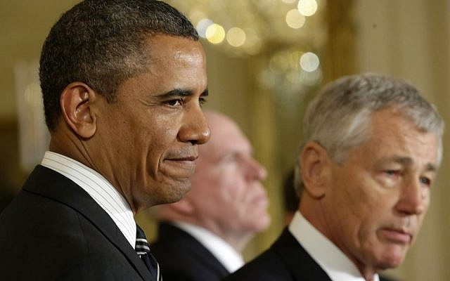 US President Barack Obama, left, stands with former Nebraska senator Chuck Hagel in the East Room of the White House, after announcing Hagel's nomination for the post of defense secretary. (photo credit: AP/Pablo Martinez Monsivais)