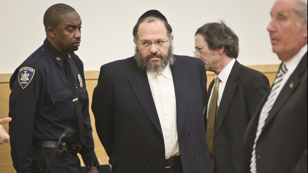 Nechemya Weberman, second left, is lead to court Tuesday, January 22, 2013, in New York. (photo credit: AP Photo/Bebeto Matthews)