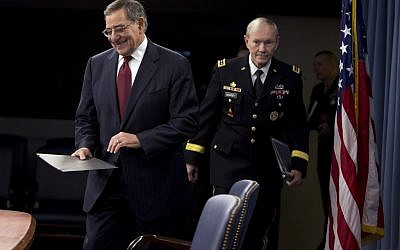 US Defense Secretary Leon Panetta and Joint Chiefs Chairman Gen. Martin Dempsey arrive for their news conference at the Pentagon on Thursday, January 10, 2013. (photo credit: Evan Vucci/AP)