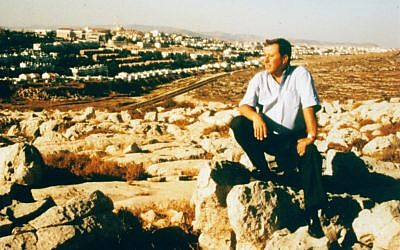 Ron Nachman perched on a rock (photo credit: Avi Zimmerman/Ariel Development Fund)