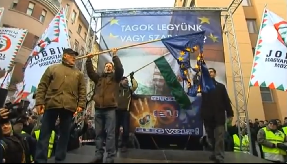 Jobbik party supporters burning an EU flag at a rally in Budapest in 2012. (photo credit: image capture from YouTube video uploaded by Euronews)