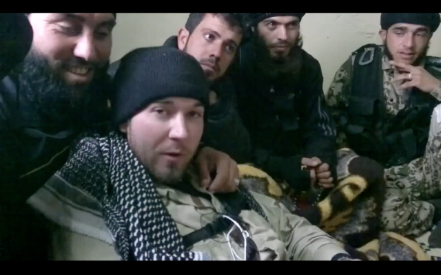 An alleged American (front) fighting with Syrian rebels against Syrian President Bashar Assad. (photo credit: image capture from YouTube video)