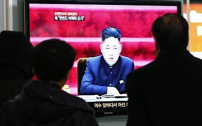South Koreans watching North Korean leader Kim Jong Un speaking on television on January 23, 2013. (photo credit: Ahn Young-joon/AP)
