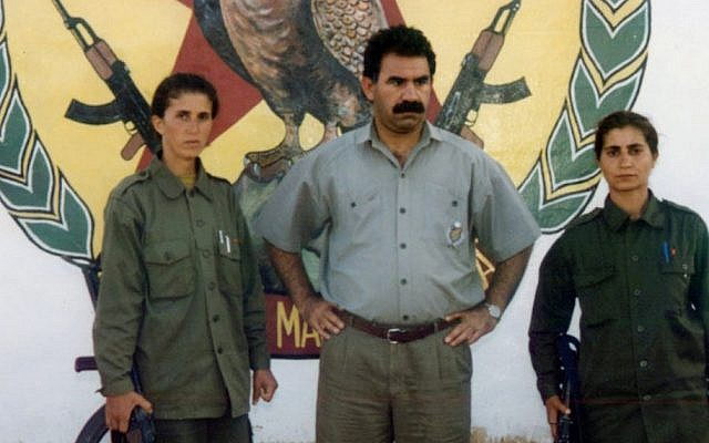PKK leader Abdullah Ocalan, center, flanked by fellow rebels. (AP/IHA)