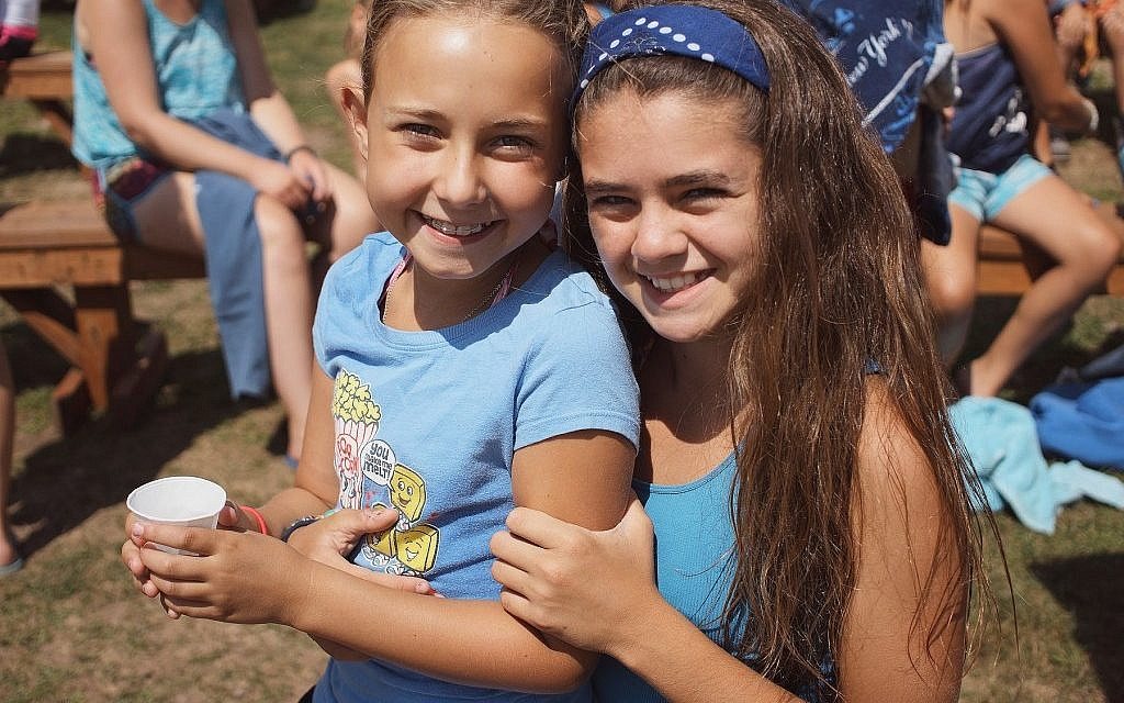 Proponents of Jewish summer camp claim the experience increases the likelihood that kids will light Shabbat candles and attend synagogue. (Courtesy of the Foundation for Jewish Camp via JTA)