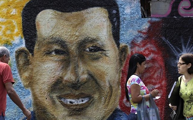 A mural of Venezuela's President Hugo Chavez decorates a wall in Caracas, Venezuela, on Wednesday (photo credit: AP/Ariana Cubillos)