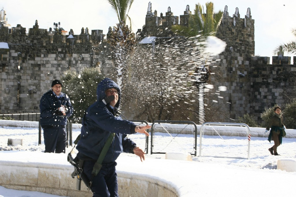 A policeman throws snowballs near the Damascus Gate in 2008 (photo credit: Nati Shohat/Flash90)