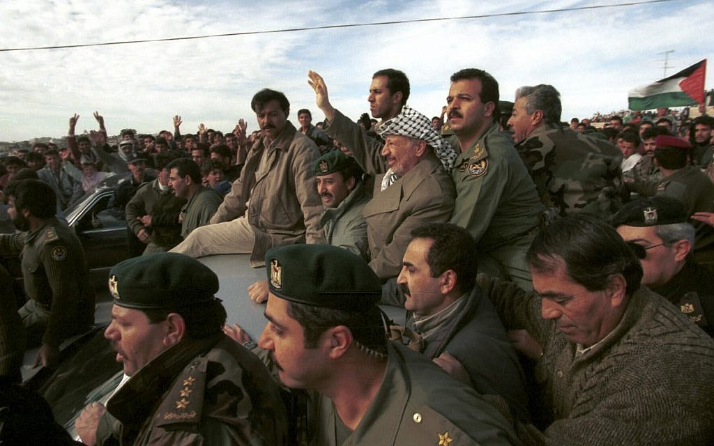 Yasser Arafat is cheered on by supporters as he visits the West Bank city of Hebron,  January 19, 1997 (photo credit: Nati Shohat/Flash90)