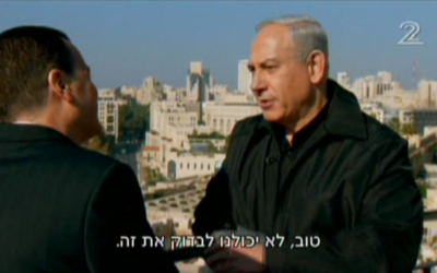 Prime Minister Benjamin Netanyahu speaks with Channel 2's Yaakov Elon on Monday. (photo credit: image capture from Channel 2)