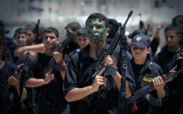 Palestinian boys take part in a Hamas graduation ceremony, July 26, 2010. (photo credit : Mustafa Hassona / Flash90)