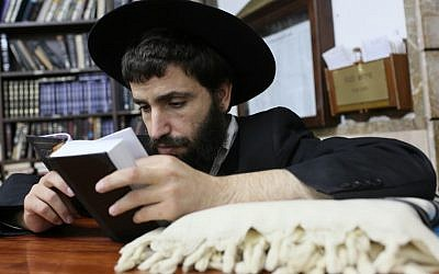 An ultra-Orthodox Jewish man prays at the 770 building in Kfar Chabad, Israel (photo credit: Nati Shohat/Flash90/File)