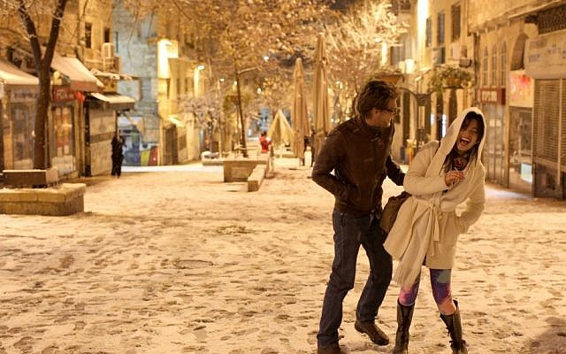 Israelis stroll through the snow covered streets of Jerusalem on Wednesday (photo credit: Nati Shohat/Flash90)