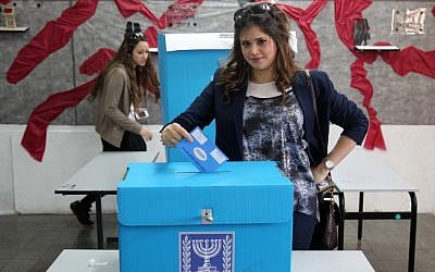 A woman casts her vote in the Jewish settlement of Beitar Illit (photo credit: Nati Shohat/Flash90)