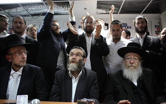 Moshe Gafni (center) and Yaakov Litzman (right) of the United Torah Judaism party in Tel Aviv, January 2013. (photo credit: Yaakov Naumi/Flash 90)