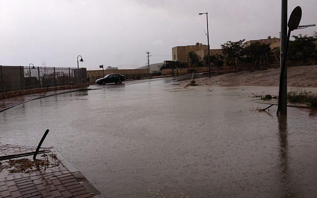 Flooded street in Kfar Adumim (photo credit: Amanda Borschel-Dan/Times of Israel)