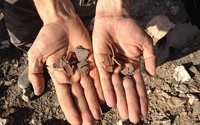 Rummaging through ancient pottery chips near the khan (photo credit: Jessica Steinberg/Times of Israel)