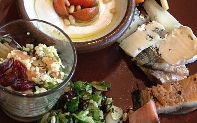 A breakfast of fresh labane, freekeh salad, cheeses and fish at Beresheet (photo credit: Jessica Steinberg/Times of Israel)