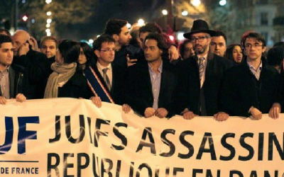 Members of the Union of French Jewish Students demonstrate in Paris with a sign that reads, 'Jews murdered, republic endangered.' (Courtesy of UEJF via JTA)