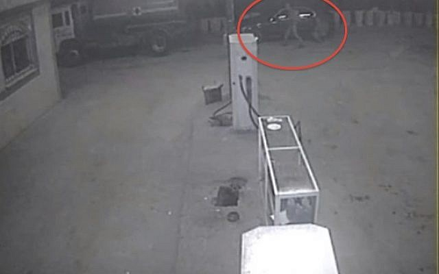 Surveillance camera captures vandals slashing the tires of vehicles at a gas station in the West Bank town of Qabalan (image capture: YouTube)