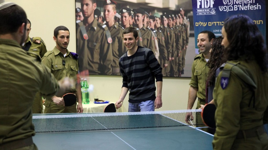Gilad Shalit plays ping-pong with lone soldiers in the IDF on Thursday (photo credit: Sasson Tiram/Nefesh B'Nefesh)